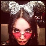 Vanessa Hudgens sported an eclectic look, including sequined Mickey Mouse ears and heart-shaped sunglasses. Source: Instagram user vanessahudgens