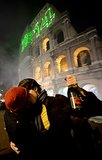 A couple shared a midnight kiss in front of the Colosseum in Rome, Italy.