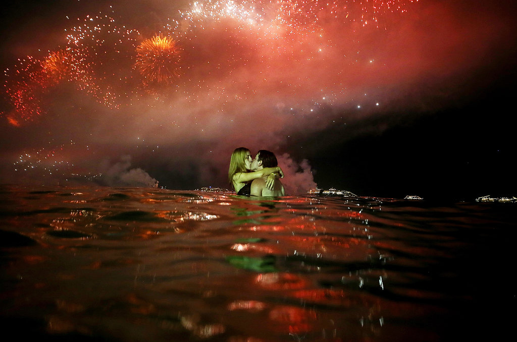 A makeout session took place under the fireworks and in the water in Rio de Janeiro, Brazil.