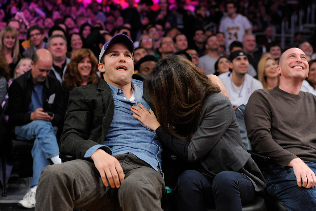 Ashton and Mila had animated reactions to the game.