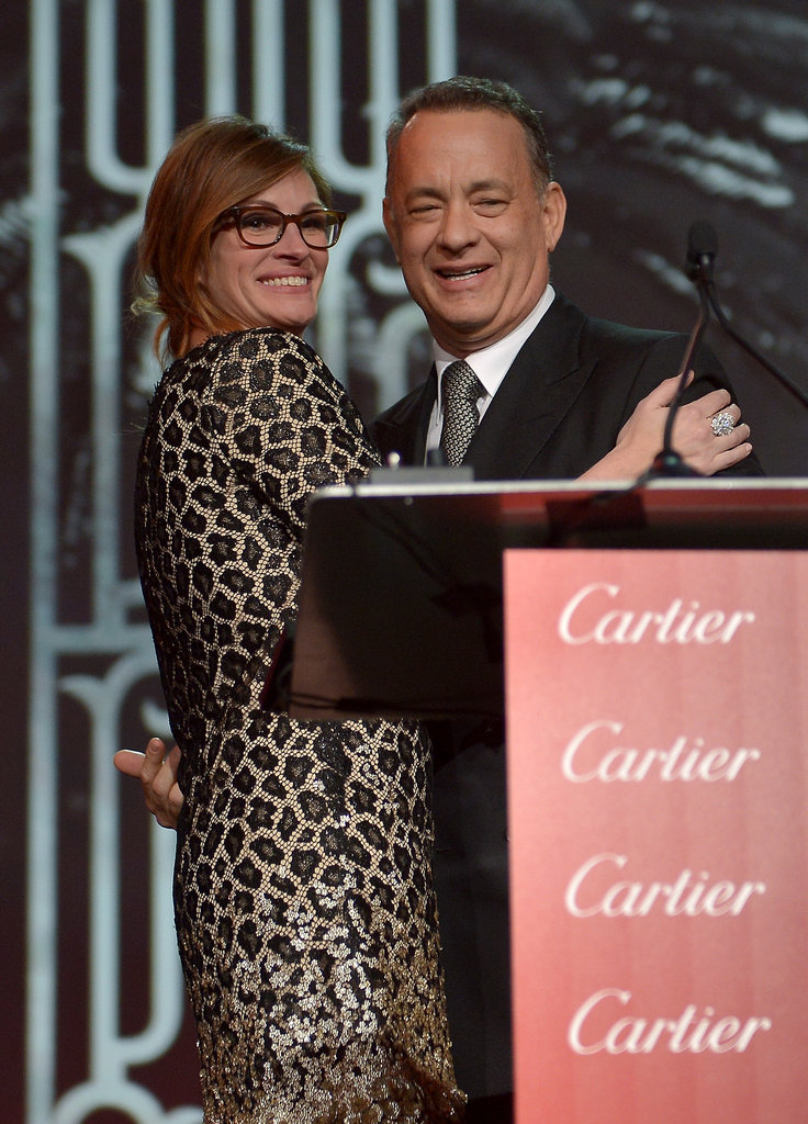 Julia Roberts presented Tom Hanks, her friend and former costar, with his chairman's award at the Palm Springs Film Festival.