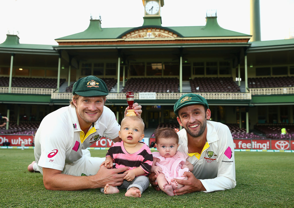 Cutest photo ever: Shane Watson and Nathan Lyon toasted their success with their children, Will and Harper.