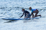 Emma Stone took a surfing lesson in Hawaii.