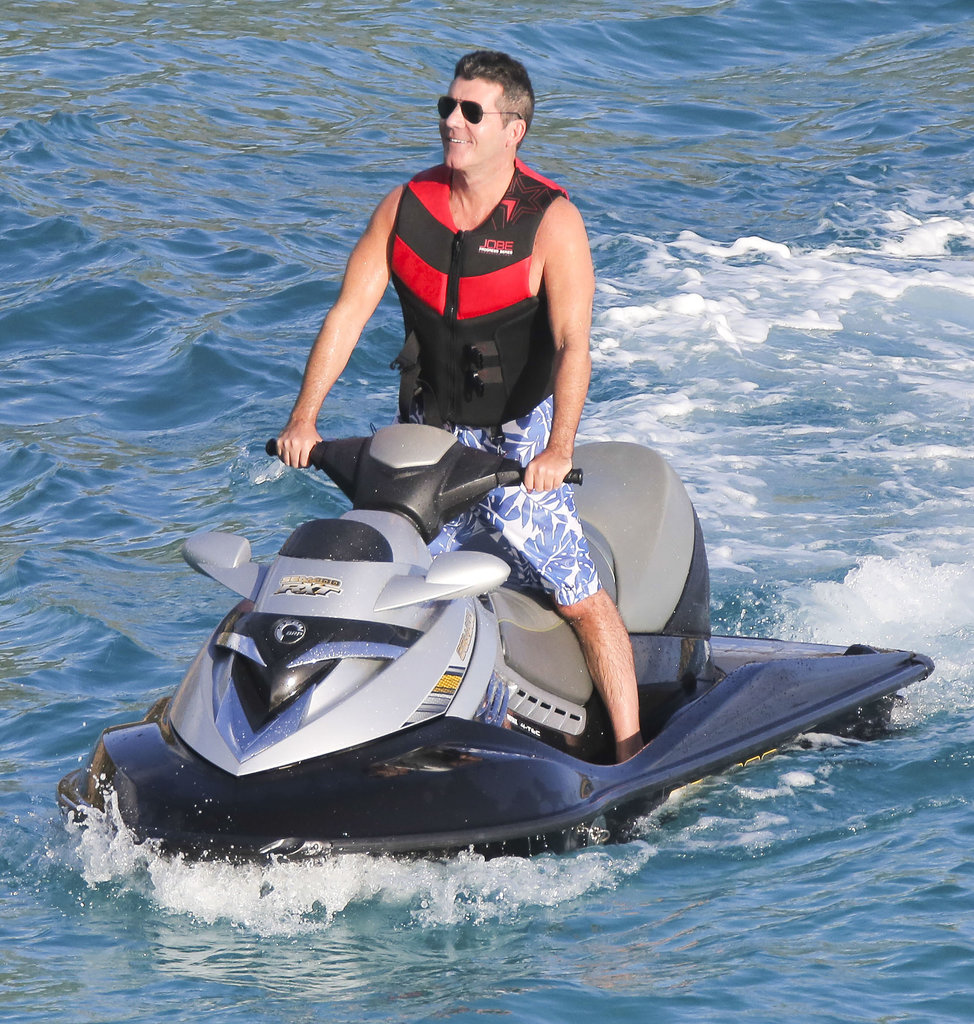 Simon smiled while jet skiing.