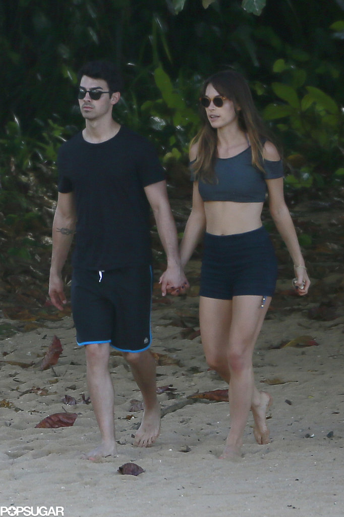 Blanda and Joe walked hand in hand.