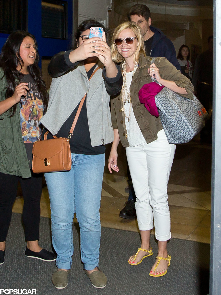 Reese Witherspoon snapped a selfie with a fan on Monday when she arrived at LAX.