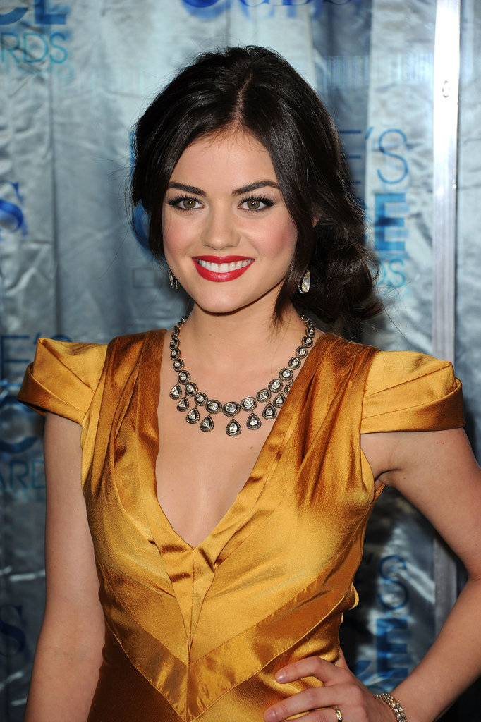 At the 2011 People's Choice Awards, Lucy went for another asymmetrical style, wearing an off-center chignon as well as thick eyelashes and a bright red lipstick.