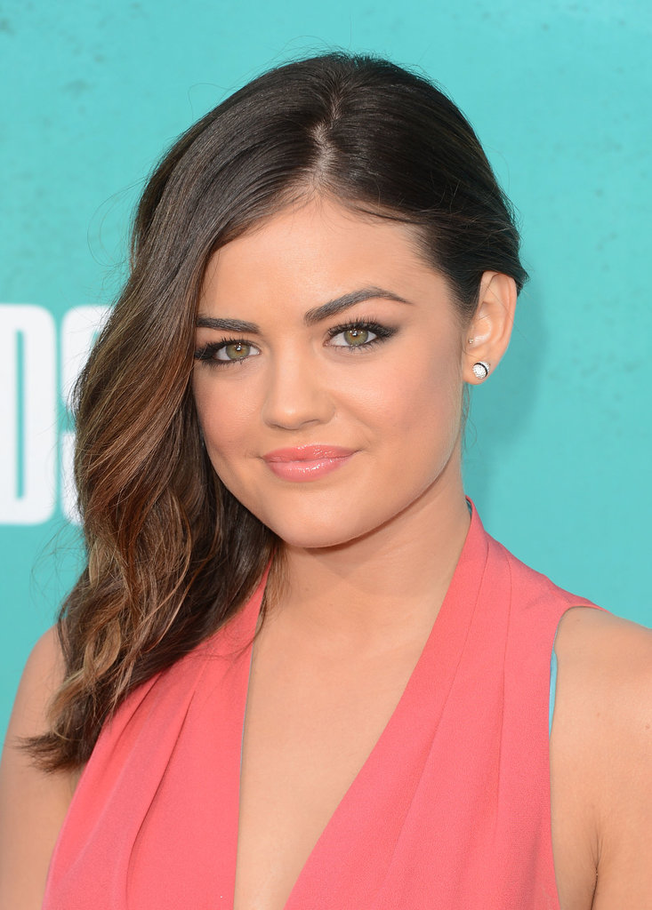 In 2012, Lucy cut her strands into a shorter lob style, but the new length didn't keep her from wearing her favorite deep side part.