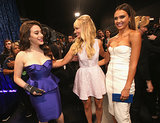 Hosts Kat Dennings and Beth Behrs shared a laugh with Jessica Alba behind the curtain.