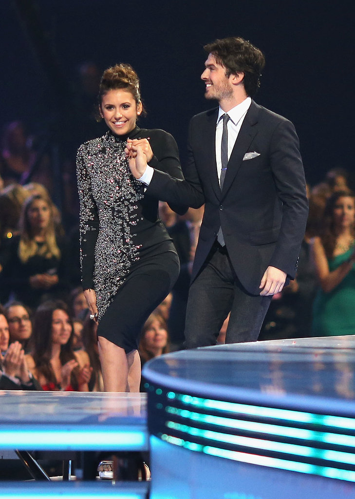 Ian Somerhalder helped Nina Dobrev up onto the stage.