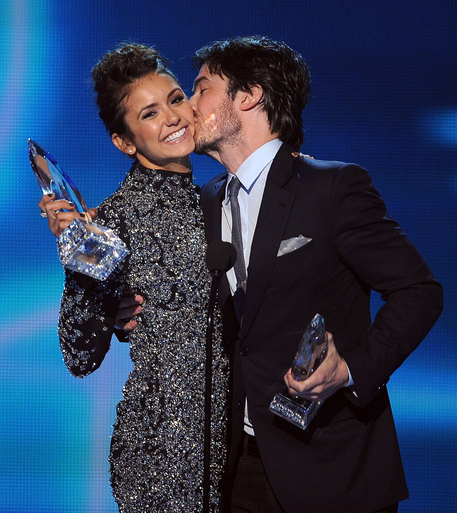 Nina Dobrev got a kiss from ex-boyfriend Ian Somerhalder at the People's Choice Awards in LA on Wednesday. The onscreen couple won favorite TV chemistry.