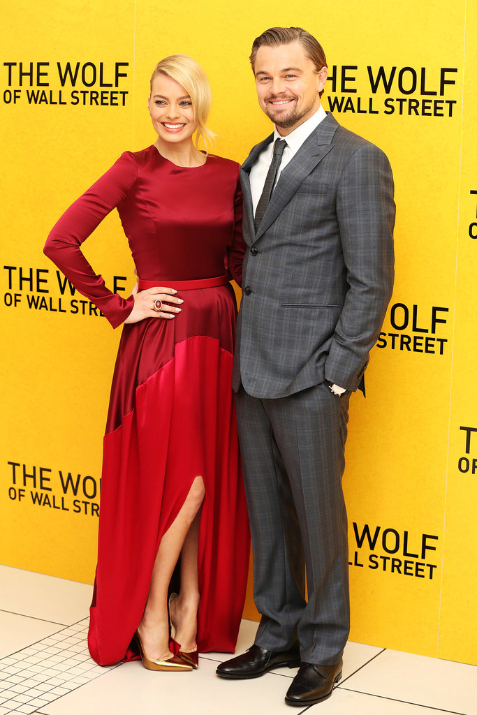 Leonardo DiCaprio smiled big when he attended the UK premiere of The Wolf of Wall Street in London with costar Margot Robbie.