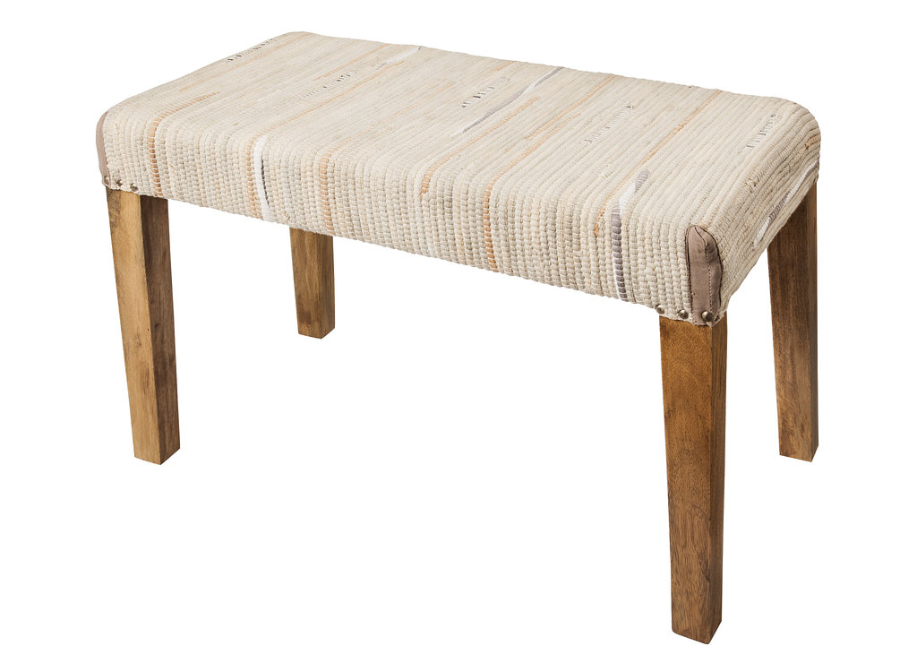 This woven bench ($110) uses rag rug material for a rustic feel.