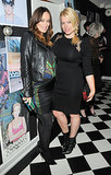 Pregnant Olivia Wilde put her bump on display while mingling with Amanda de Cadenet.