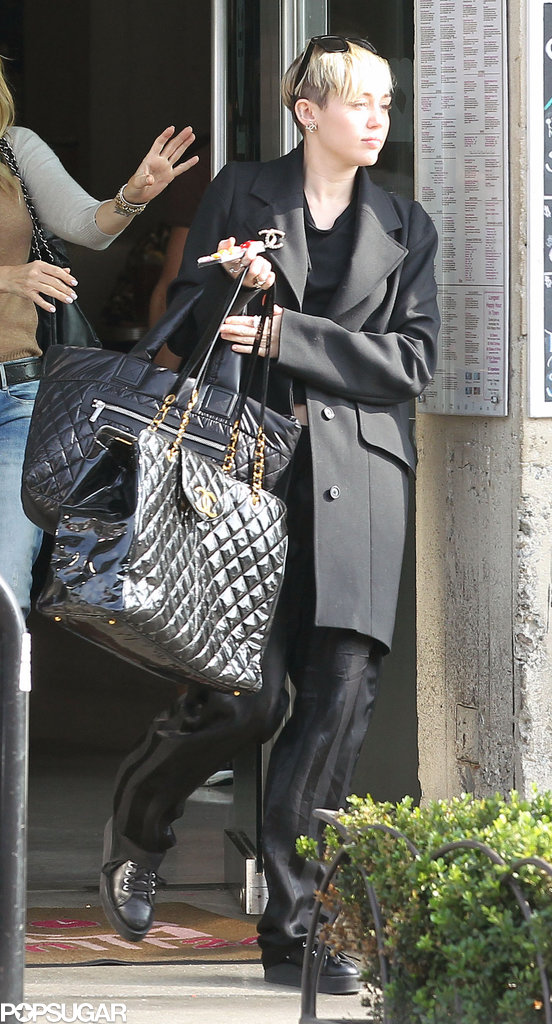 Miley carried several Chanel bags while running errands in LA.