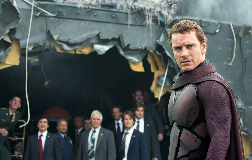 Magneto stands in the midst of wreckage.