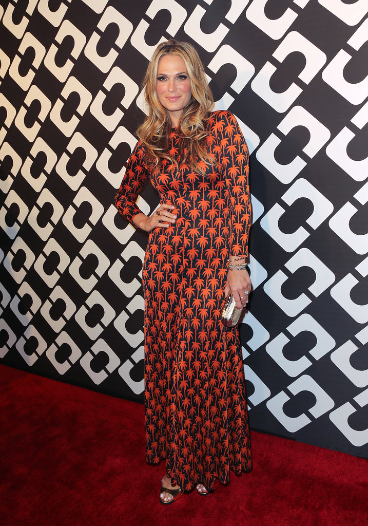 Molly Sims also did vintage, accessorizing her long-sleeved style with shoes and a clutch from the current line.