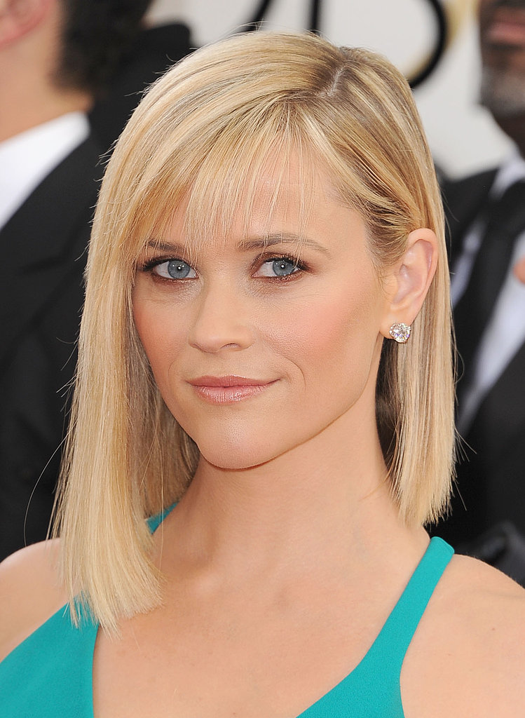 Reese Witherspoon's bronzed shadow made her blue eyes really pop, while her wispy bangs gave her sleek locks a less structured finish.