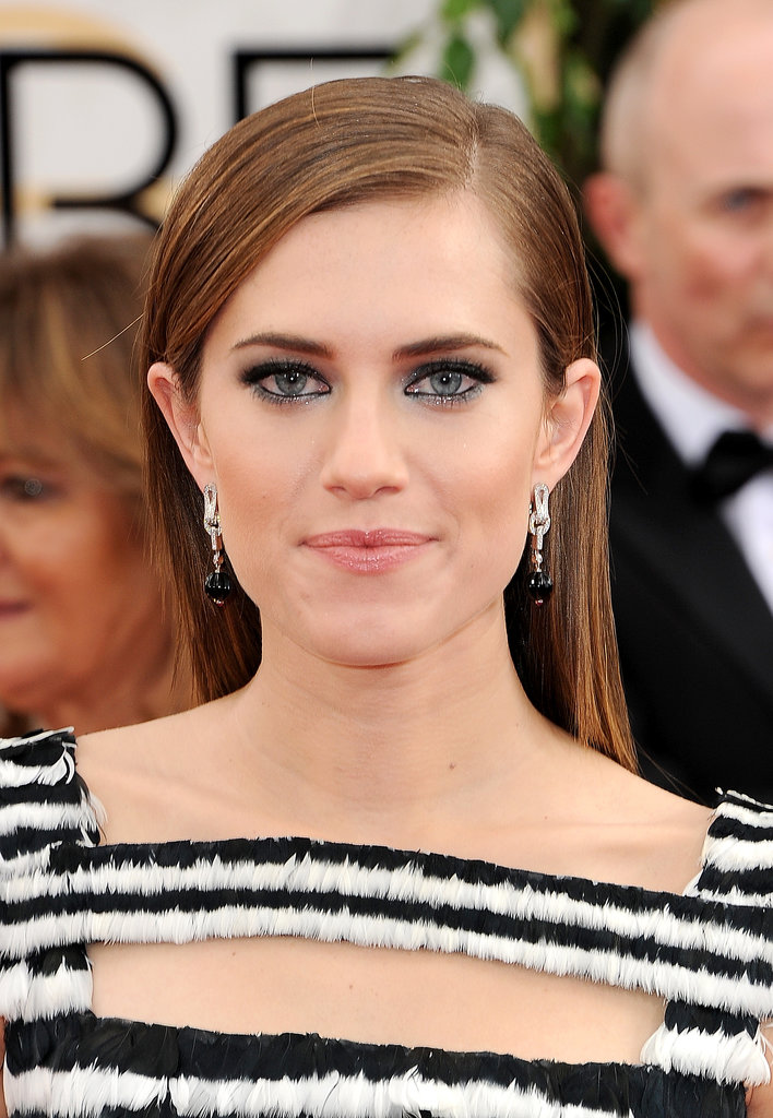 Playing up the black and white theme, Allison Williams matched her textural gown with a silver-and-black beauty palette.