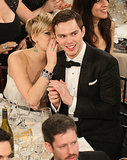 Jennifer Lawrence whispered something to her boyfriend, Nicholas Hoult.  Source: Christopher Polk/NBC/NBCU Photo Bank/NBC