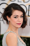 A silvery shadow, punchy lip, and coiled bob completed Tatiana Maslany's red carpet look.