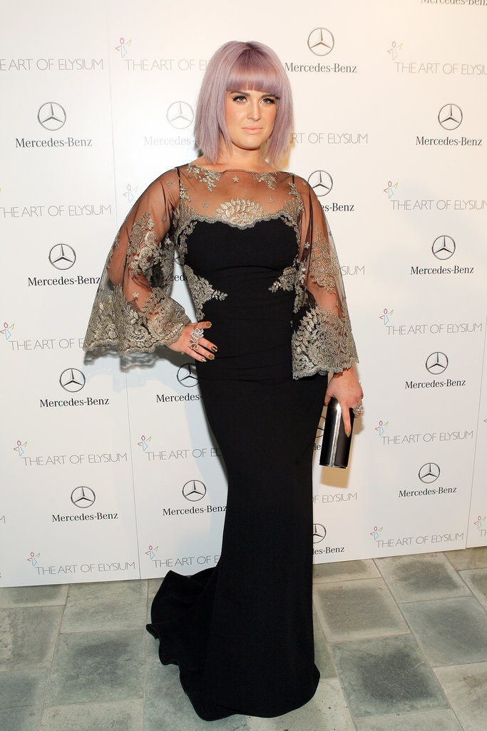 Kelly Osbourne wore a black and lace frock.