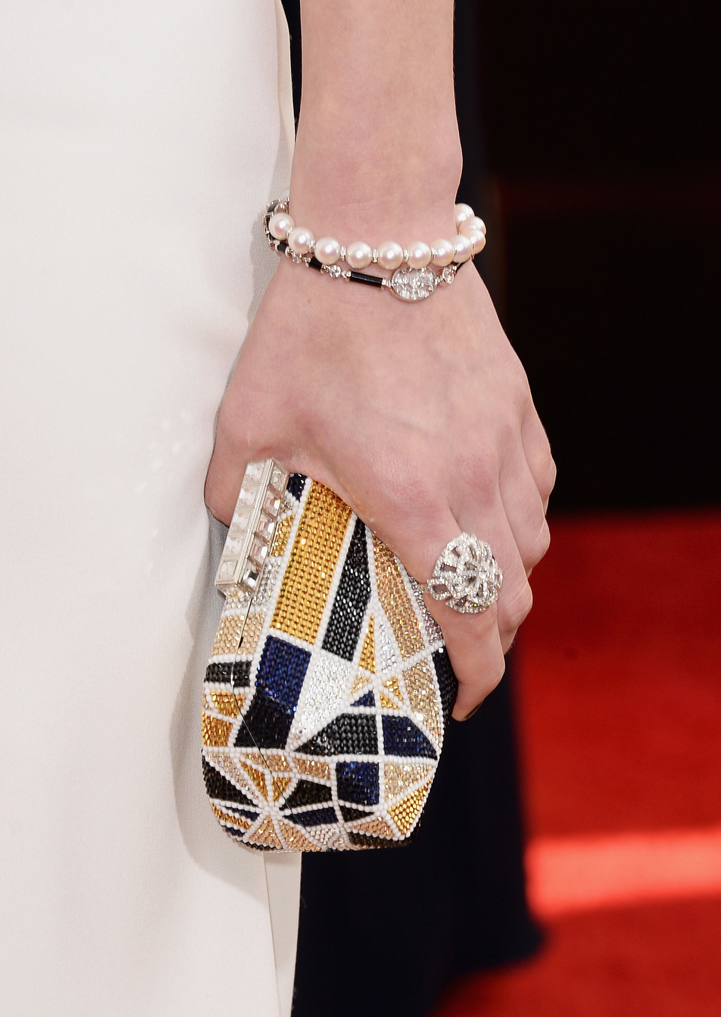 Laura Carmichael's multicolored minaudière and Chanel fine jewelry ring and bracelet were perfectly matched.