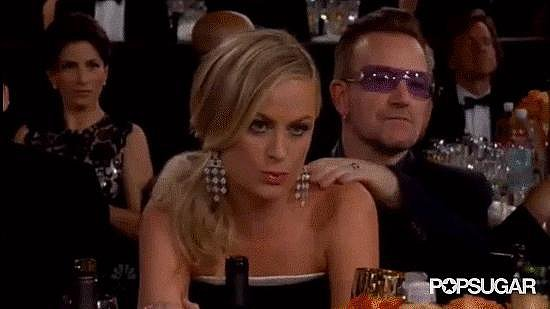 Last year: Amy spent a portion of her evening canoodling with George Clooney.  This year: Bono did the honors of rubbing her shoulders to relax her before she won.  Winner: 2013. You can't top Clooney. You just can't.