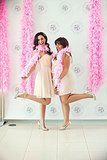 You obviously need pink feather boas for photo ops. Photo by Serendipity Studios