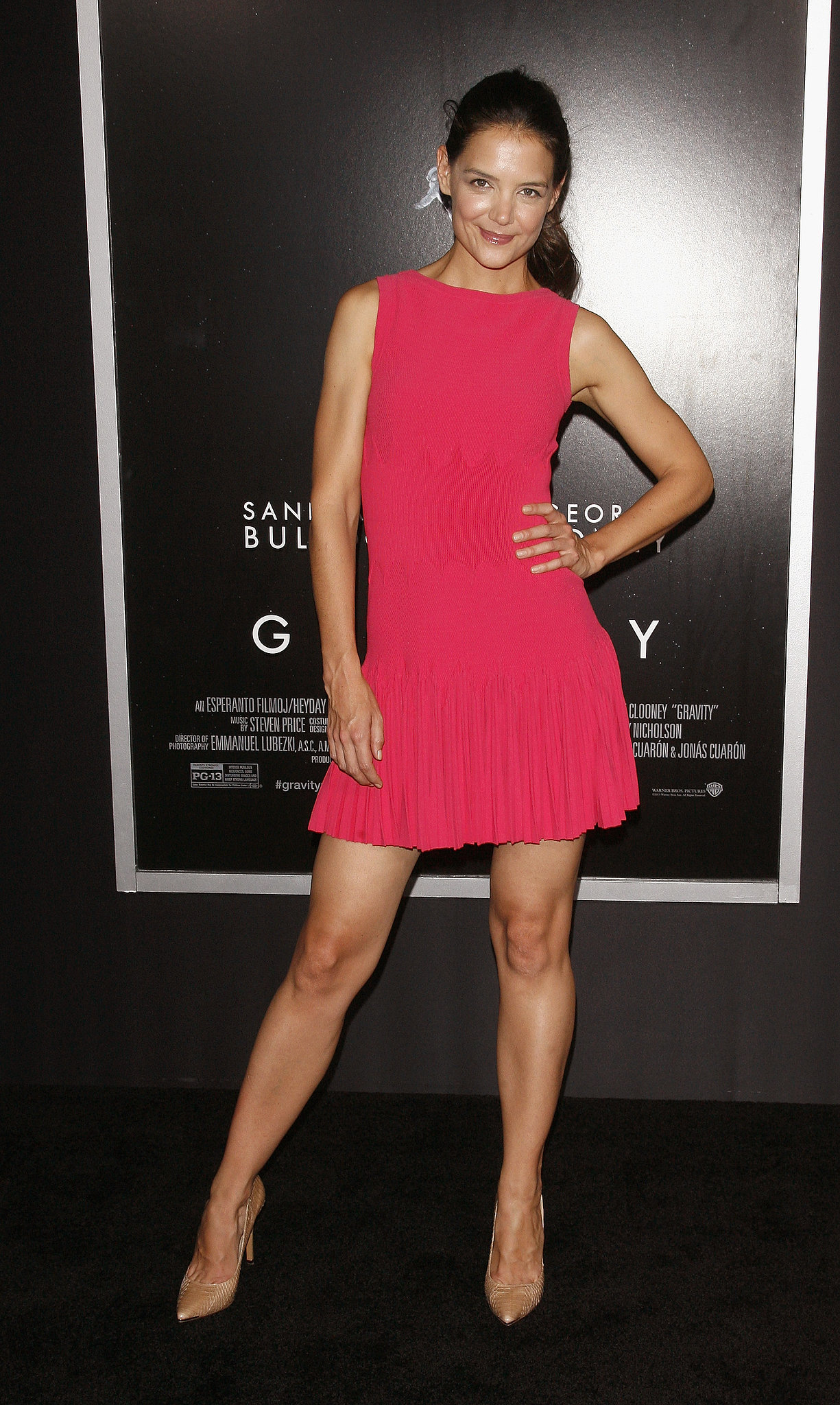 For the NYC premiere of Gravity, Katie Holmes popped in a bright pink pleated minidress by Azzedine Alaïa. Where to Wear: Sunset ice skating. Don't forget a pair of thick tights.