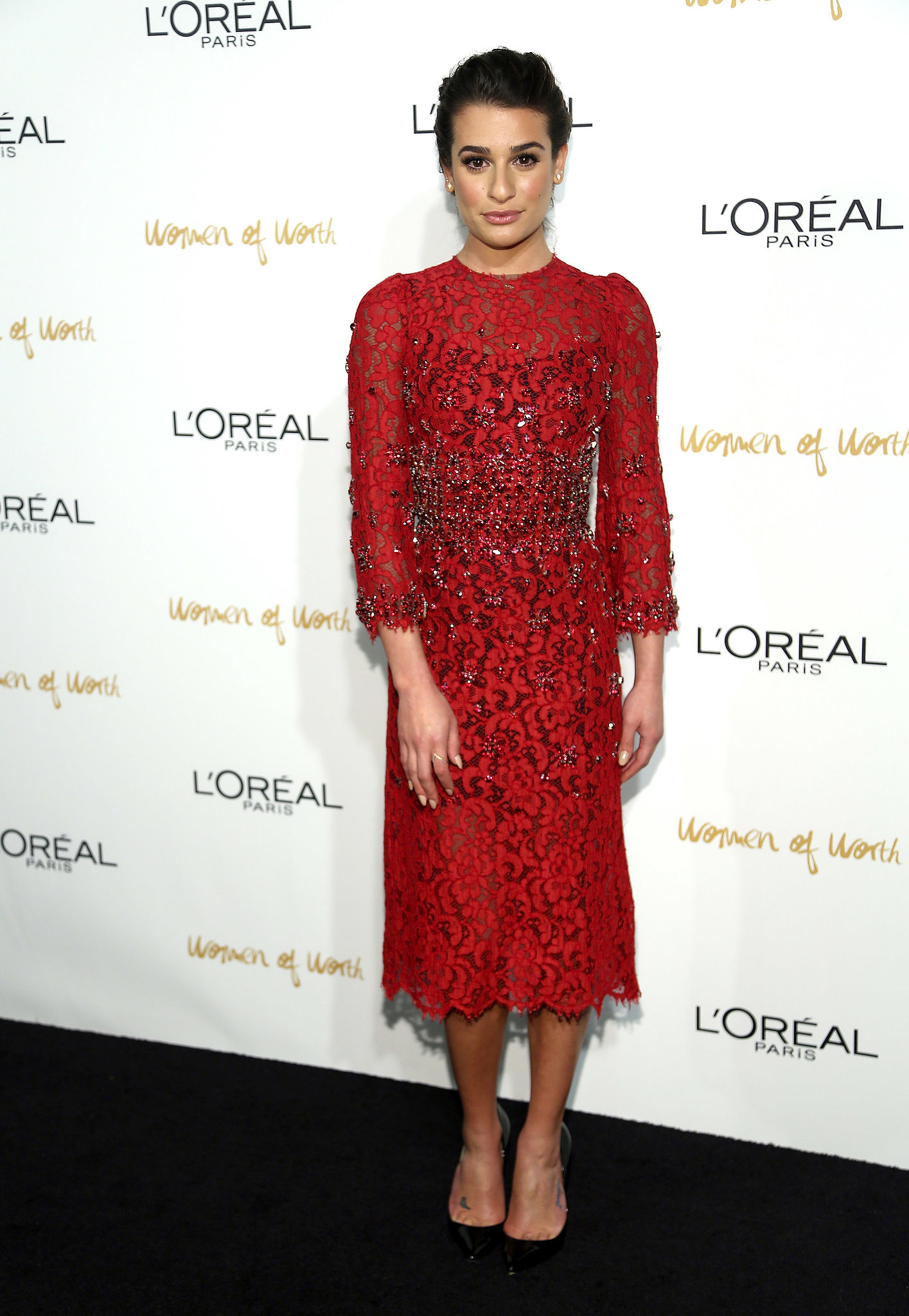 Hello, gorgeous! Lea Michele partied the night away in a decorated lace dress by Dolce & Gabbana at the Women of Worth event in December 2013. Where to Wear: Catching your favorite Broadway play