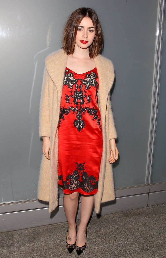 Lily Collins showed her sultry side in a red slip dress adorned with black lace in November 2013.  Where to Wear: A few rounds of sushi and sake with your BFF.