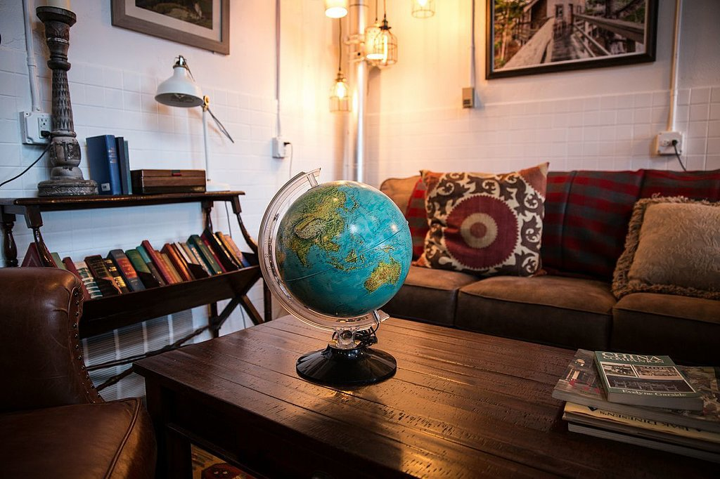 The main communal space is warm and homely due to the mix of modern and vintage decor.  Photo by Michael Friberg via Airbnb
