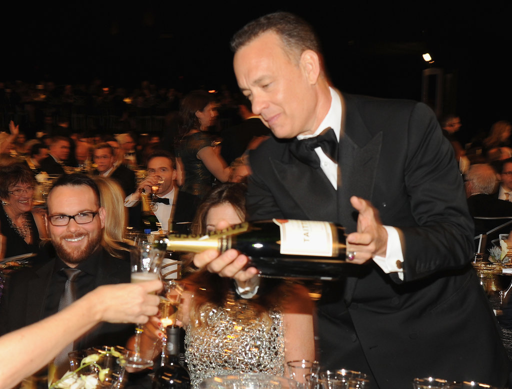Tom Hanks poured Champagne at his table.