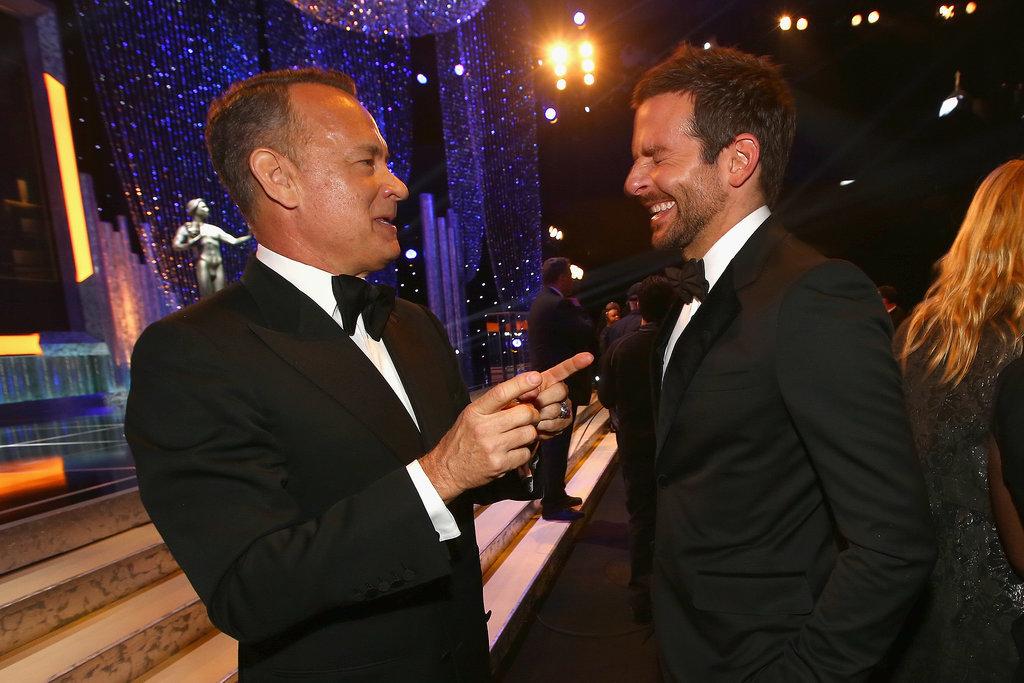Tom Hanks and Bradley Cooper laughed.