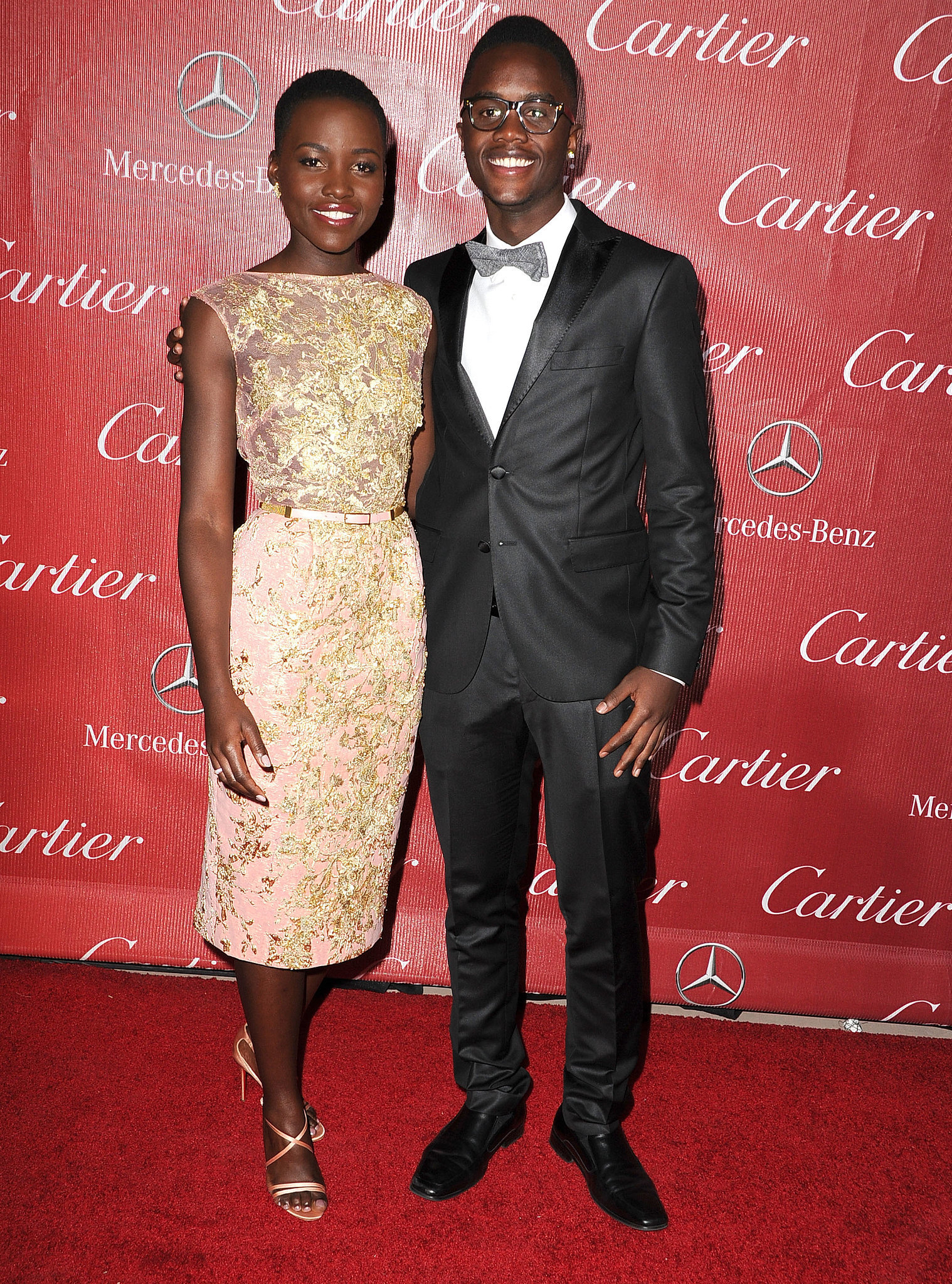 Lupita Nyong'o kicked off award season at the Palm Springs Film Festival, where she brought her brother, Peter, as her handsome date.