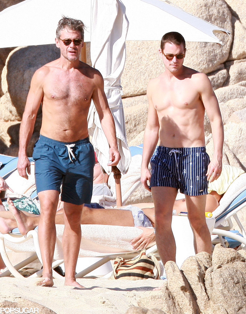 Matt Bomer and Simon Halls donned their swimsuits on the sand.