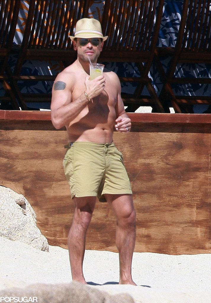 Mark Consuelos sipped a drink on the beach.