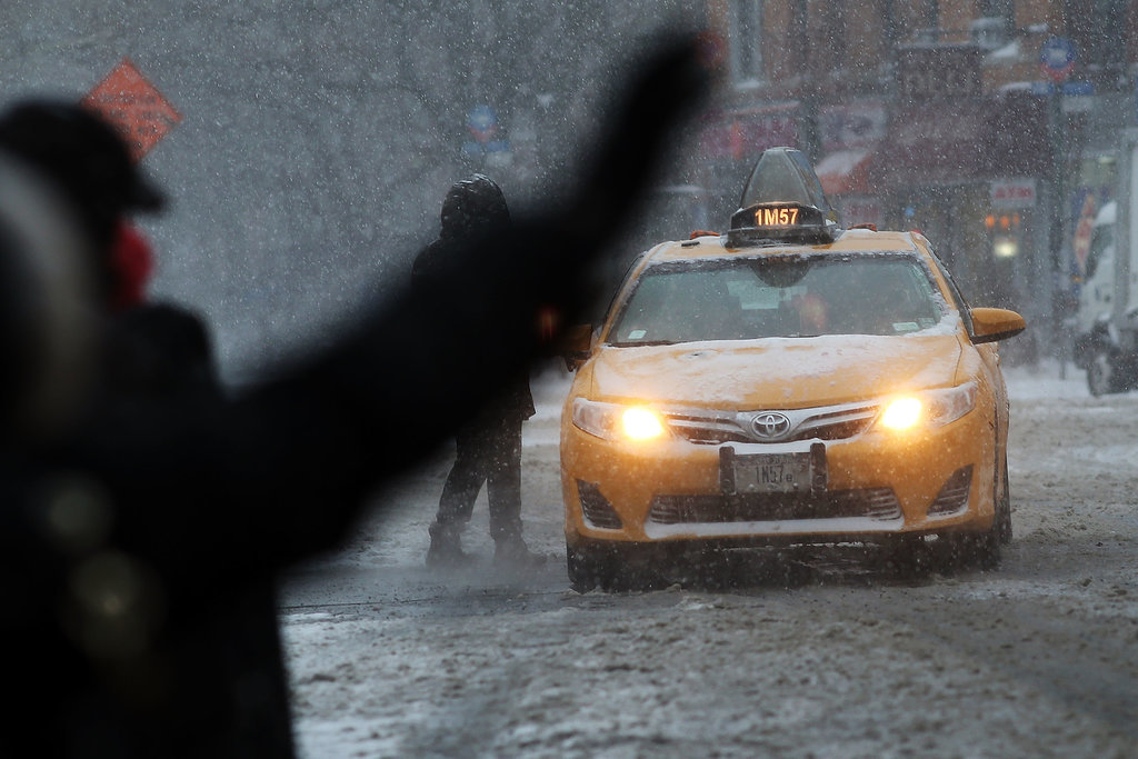A New Yorker tried to hail a cab in the middle of the snowstorm.