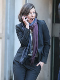 Milla Jovovich stuck a care-free pose on the set of her new political thriller, Survivor, which also stars Dylan McDermott, in London on Tuesday.