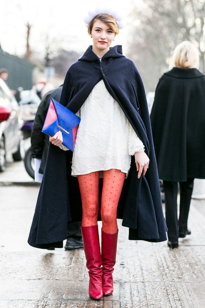 Like the modern Little Red Riding Hood — but, well, with red tights and a navy cape.
