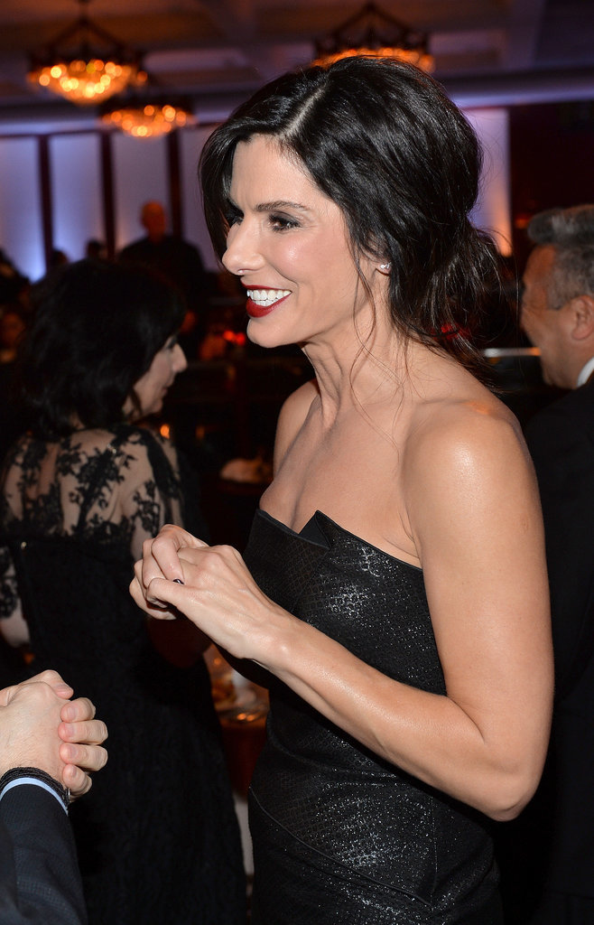 Sandra Bullock flashed a big grin during the event.