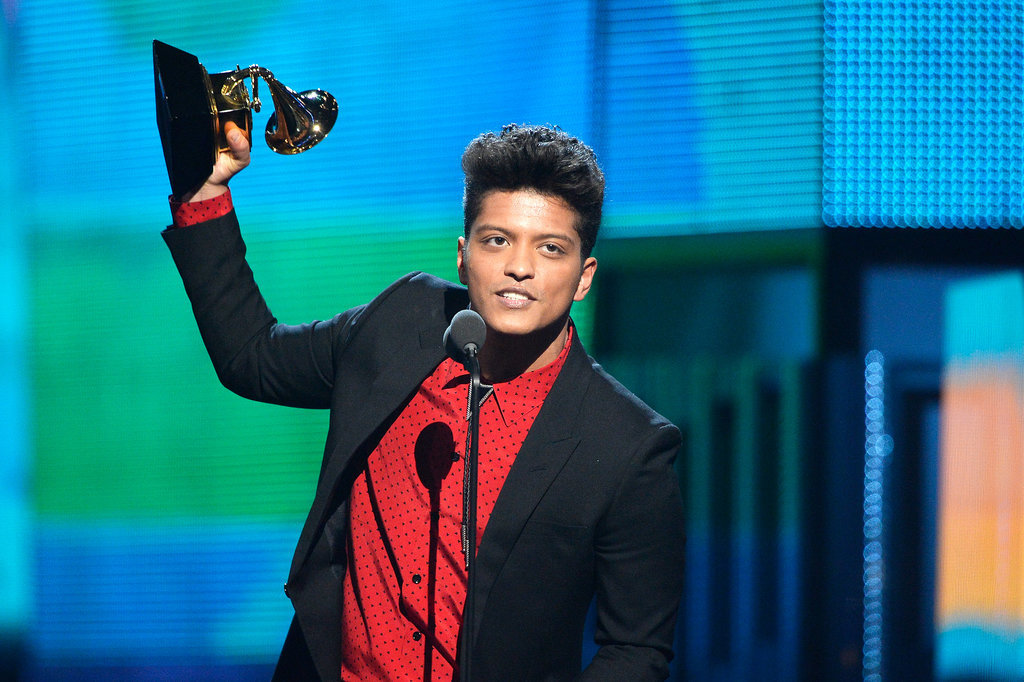 Bruno Mars accepted his award by hoisting it in the air.