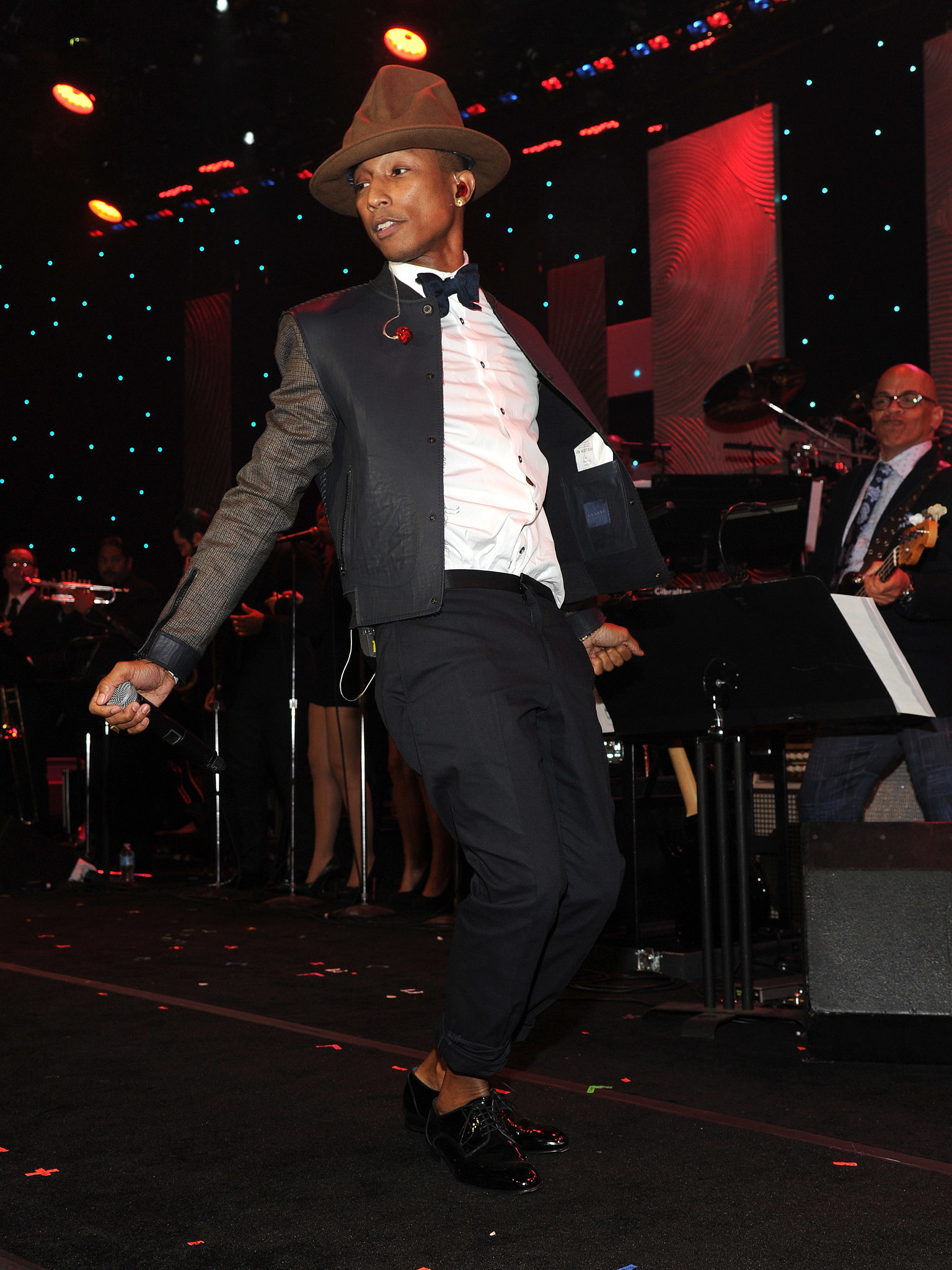Pharrell Williams performs onstage during the 56th annual GRAMMY Awards Pre-GRAMMY Gala and Salute to Industry Icons honoring Lucian Grainge at The Beverly Hilton