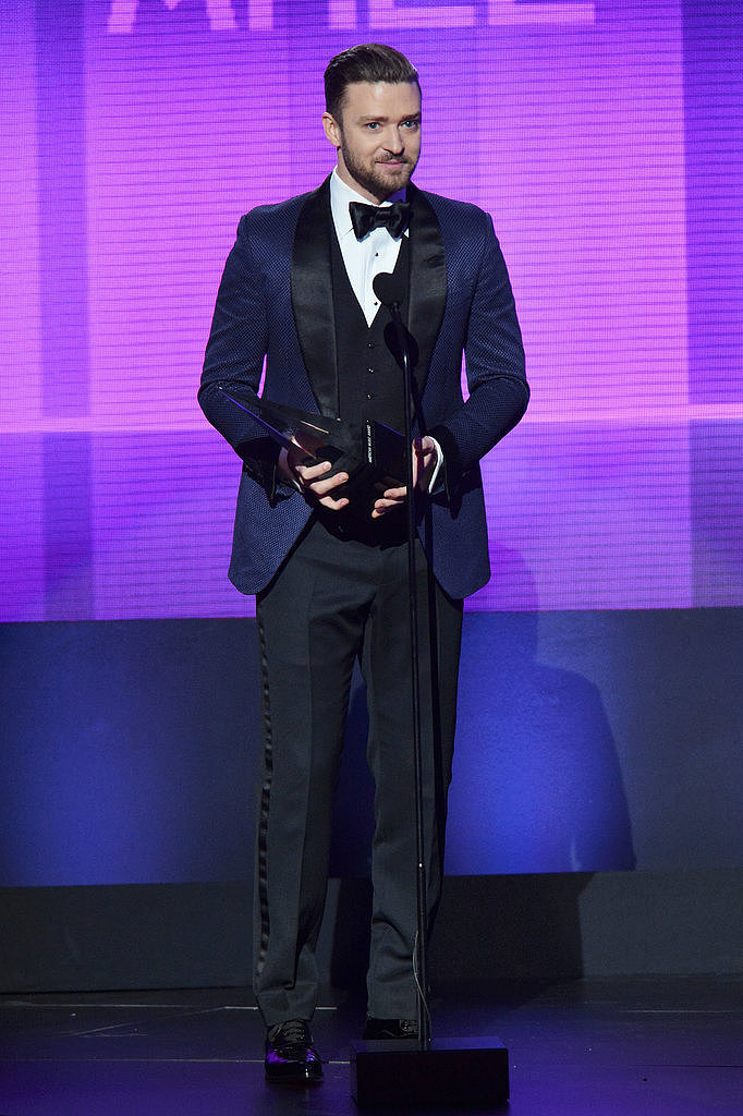 To accept his honors at this year's American Music Awards, Timberlake ditched class black for a navy suit jacket and smart bow tie.