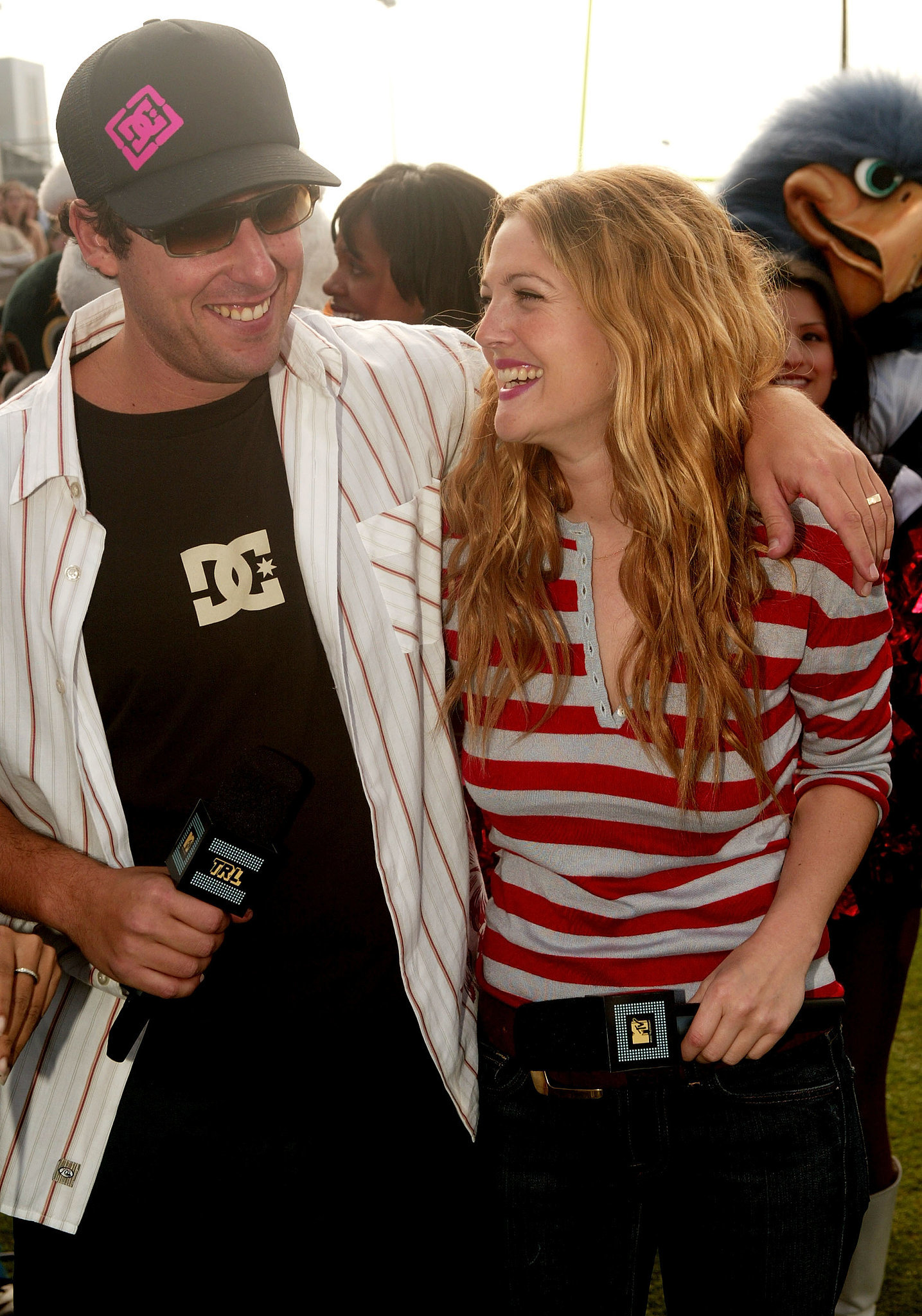 Adam Sandler and Drew Barrymore shared a laugh in Houston at MTV's TRL at Super Bowl XXXVIII in 2004.