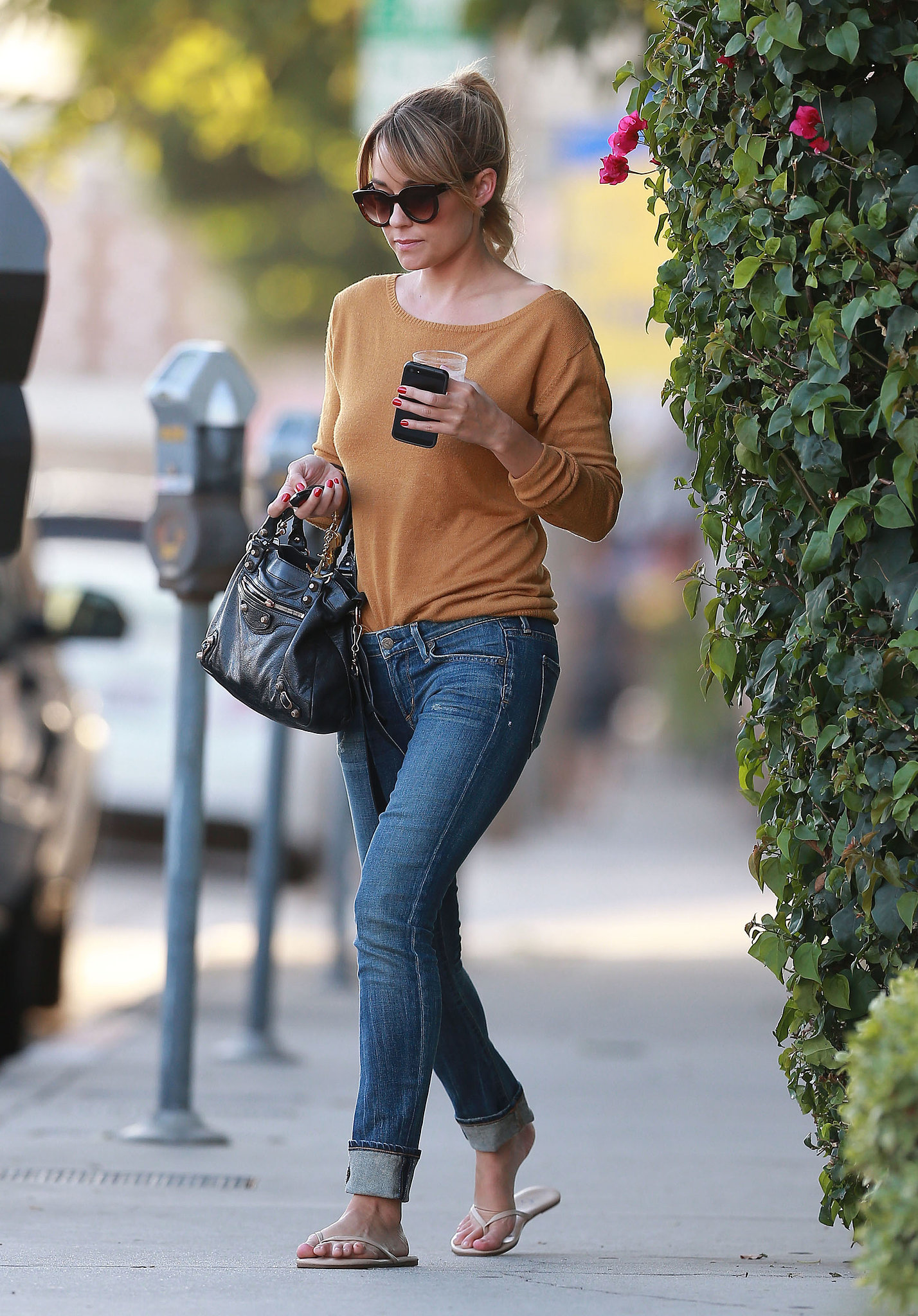 Looking minimalist-chic, Lauren styled her cuffed denim with an off-the-shoulder camel sweater and nude flip flops in West Hollywood. Lesson from Lauren: sometimes it's good to get back to basics.
