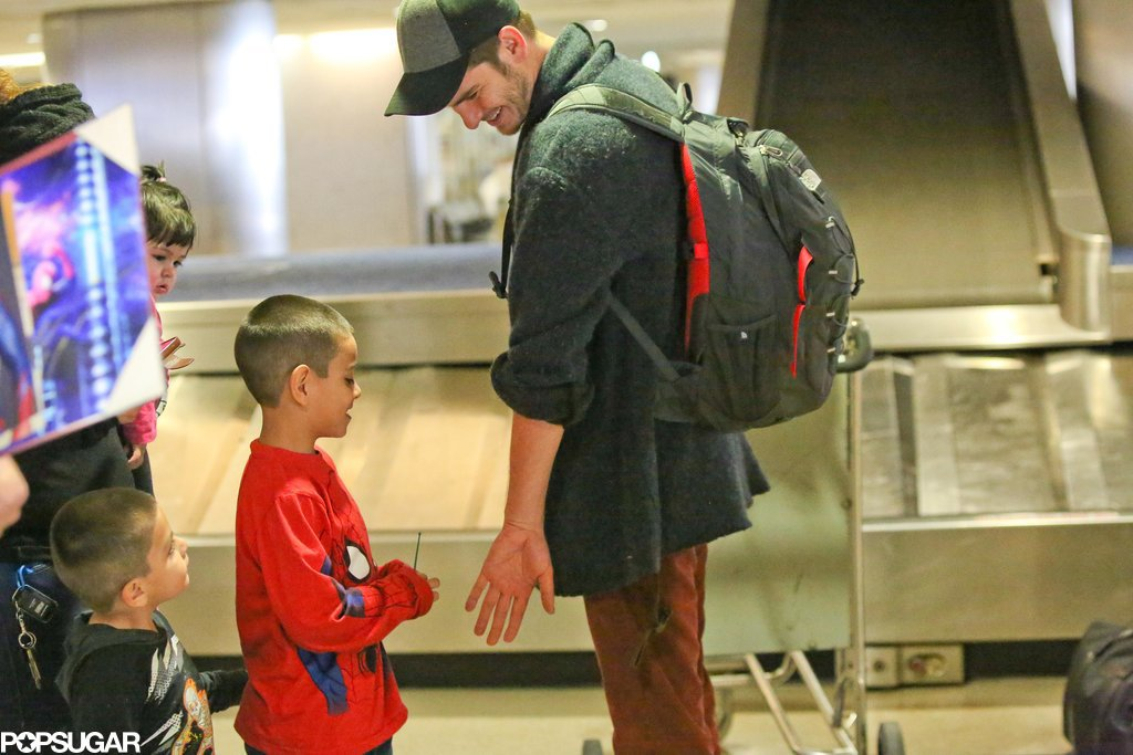 Andrew Garfield melted everyone's hearts when he greeted a tiny Spider-Man fan at the airport.