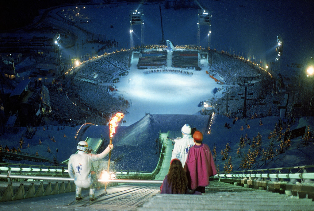 For the 1994 Lillehammer, Norway, Games, a skier carried the torch down a supersteep slope.