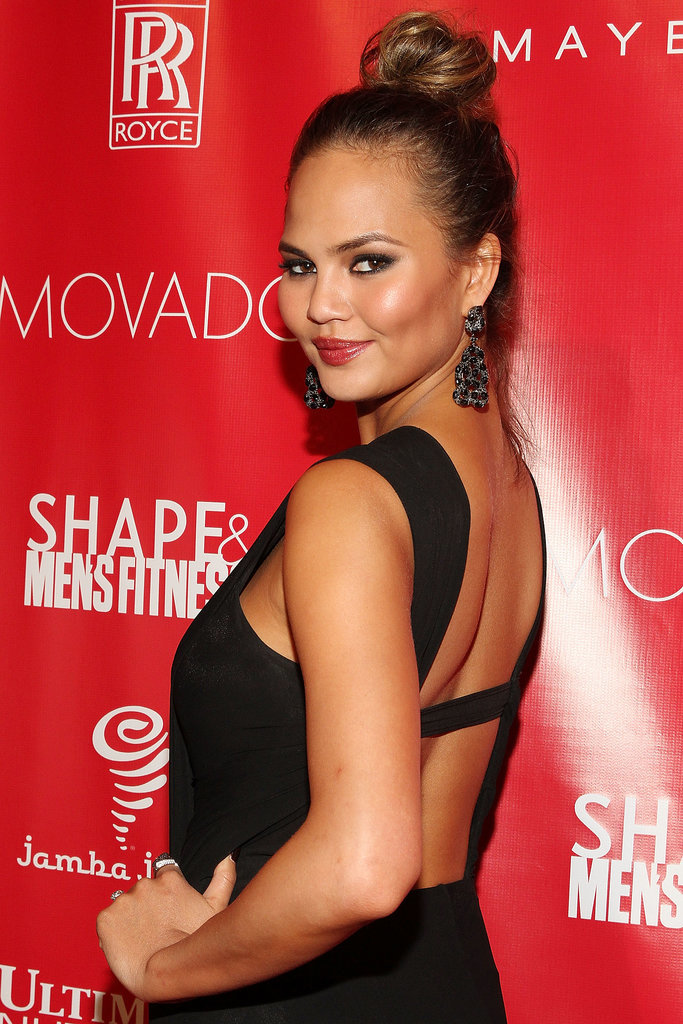 Chrissy Teigen arrived at the Shape and Men's Fitness party looking glamorous and gorgeous.